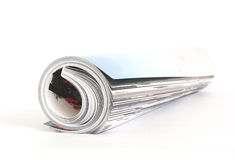 Magazine roll. Shot of the magazine roll (Shallow DOF) on a white background with pretty shadow royalty free stock photo