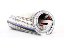 Magazine roll. Close-up of a rolled magazine royalty free stock photography