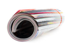 Magazine Roll. Shot of the magazine roll (Shallow DOF) on a white background with pretty shadow Royalty Free Stock Photos