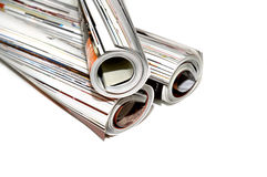 Magazine roll. Three magazines rolled up stock images