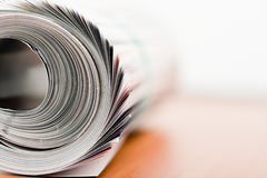 Magazine roll. On white background Stock Photos