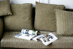 Magazine on Sofa Stock Photos