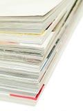 Magazine stack. Stack of magazines isolated on a white background Stock Photos
