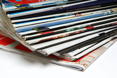 Magazine stack. A stack of colourful magazines on white surface Royalty Free Stock Image