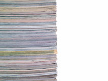 Magazine Stacked Half Frame. A stack of magazines filling the frame from top to bottom with copyspace on right Royalty Free Stock Photos