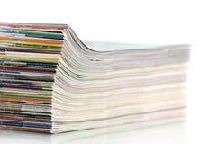 Magazines. Pile of magazines on a white background Stock Photos