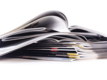 Magazines. Pile of magazines over white Stock Images