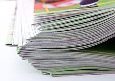 Magazines. Stack of magazines, low angle closeup Royalty Free Stock Photos