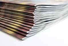Magazines. Stack of magazines, low angle closeup Stock Photos