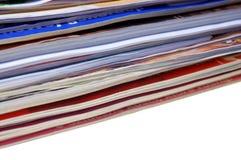 Magazines. Stack of magazines on white background royalty free stock images