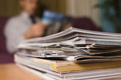 Magazines. A man in a waiting room reading magazines Royalty Free Stock Photo