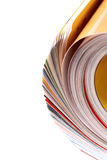 Magazines. Rolled up magazine. Multicolor pages Stock Image