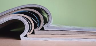 Magazines. Open magazines with green background Royalty Free Stock Photography