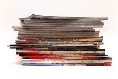 Magazines. Stack of magazines isolated on white Stock Photo