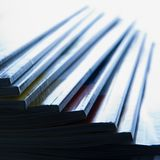 Magazines. Pile of glossy periodical magazines - light effect Royalty Free Stock Images
