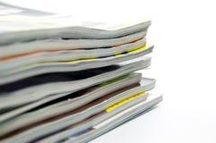 Magazines. Pile of magazines on white background Royalty Free Stock Images