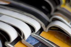 Magazines. Stack of different magazines lying on the table stock photos