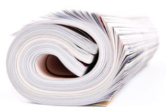 Magazines. Three color magazines rolled on white background royalty free stock photo
