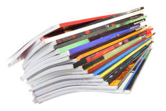 Magazines. Pile of colorful magazines isolated over white background Stock Photo