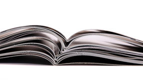 Magazines and books stack stock images