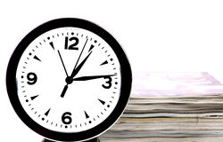 Magazines and clock Royalty Free Stock Images
