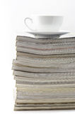 Magazines and coffee cup Royalty Free Stock Photo