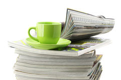Magazines and coffee cup Royalty Free Stock Image