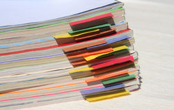 Magazines with colored tabs. A stack of magazines with colored tabs Royalty Free Stock Image