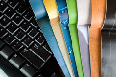 Magazines and computer. Open magazines and computer keyboard, new media and technology Stock Images