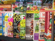 Magazines cover pages. Berlin, Germany - October 10, 2018: Newsstand interior, cover pages of German magazines displayed on a stand for sale stock photos