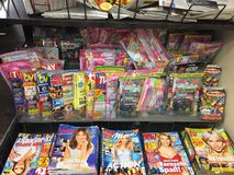 Magazines cover pages. Berlin, Germany - October 10, 2018: Newsstand interior, cover pages of German magazines displayed on a stand for sale stock image