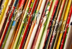 Magazines covers. Various colorful magazines covers on bookshelf closeup royalty free stock photos