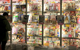 Magazines in press stand. Magazines displayed for sale in press stand Royalty Free Stock Image