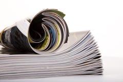 Magazines empilées et roulées Photographie stock libre de droits