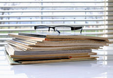 Magazines with glasses Royalty Free Stock Photos