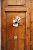 Magazines in a letterbox of a door Royalty Free Stock Images