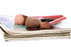 Magazines and makeup brushes Royalty Free Stock Photo