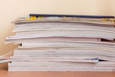 Magazines. Pile of old magazines on a desk Stock Photo