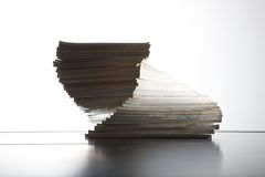 Magazines piled on table Royalty Free Stock Image