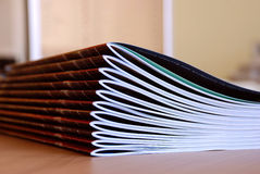 Magazines in row. Magazines on the desk close-up Stock Photography