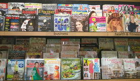 Magazines on shelves Royalty Free Stock Images