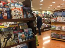 Magazines on shelves for sale. At book store, TX USA Stock Photography