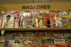 Magazines on shelves in store Stock Image