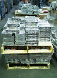 Magazines on skids in warehouse. Some magazines stacked on skids in a warehouse stock photography