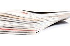 Magazines up close shot on white background Royalty Free Stock Photos