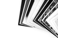 Magazines up close shot on white background. Mono magazines up close shot on white background stock photography