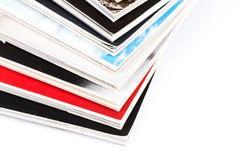 Magazines up close shot on white background. Mono magazines up close shot on white background royalty free stock photography