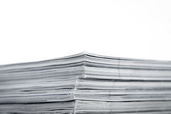 Magazines up close shot on white background. Mono magazines up close shot on white background stock image