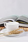 Magazines and white cup of coffee Royalty Free Stock Image