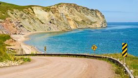 Magdalen Islands, Iles de la Madeleine road. Magdalen Islands dirt road and beach stock images